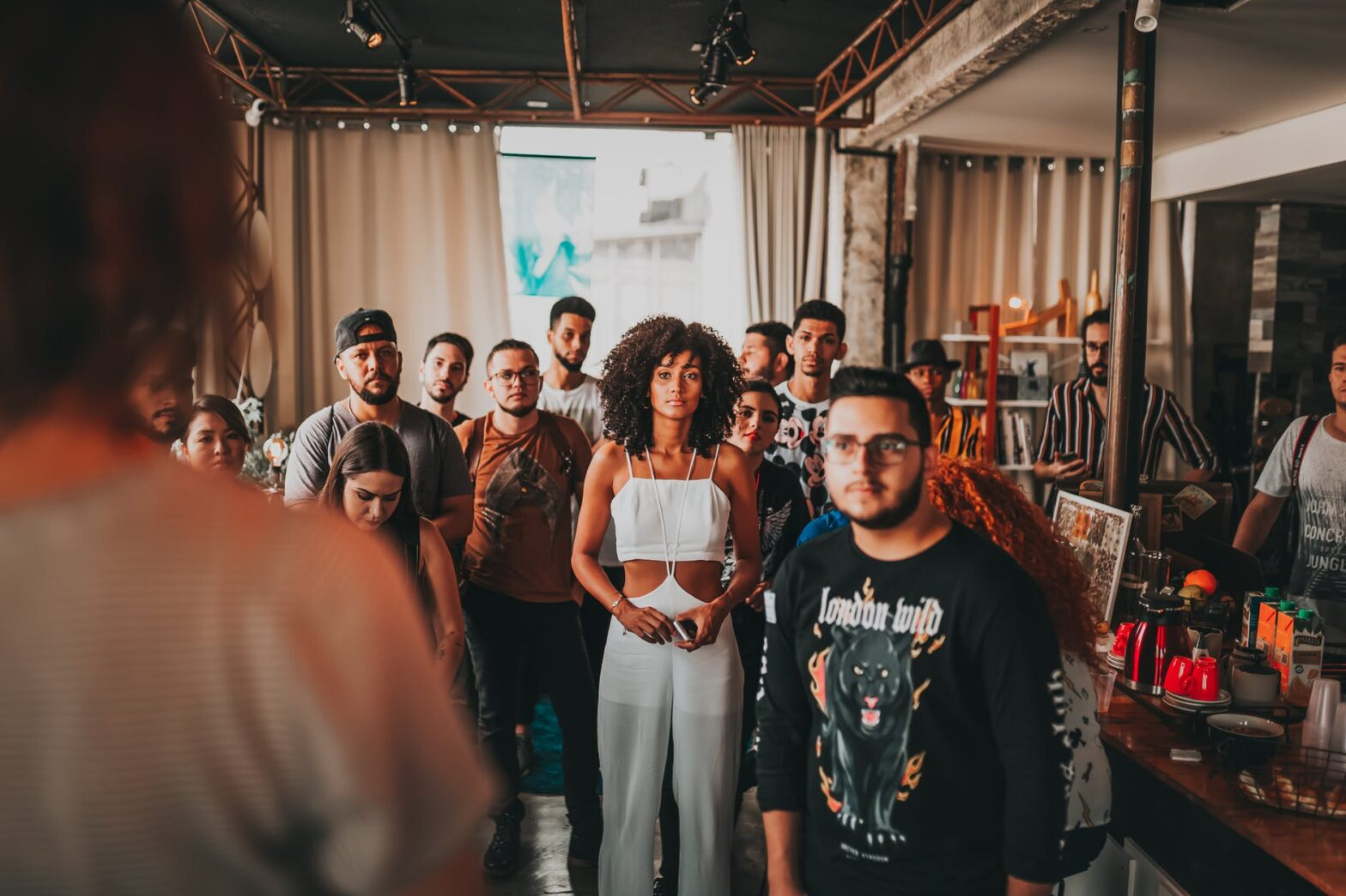 diverse people listening to speaker in modern studio